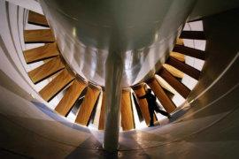 Man_examining_fan_of_Langley_Research_Center_16_foot_transonic_wind_tunnel_Wikimedia_CC0_B